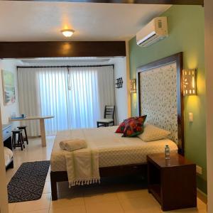 Cama o camas de una habitación en Hotel Boutique Kinich