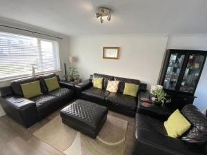A seating area at Deluxe double room close to train station