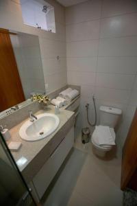 A bathroom at Onix Bueno Residence