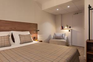 Un ou plusieurs lits dans un hébergement de l'établissement Maison Barbillon Grenoble