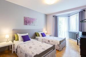 Posteľ alebo postele v izbe v ubytovaní The Secret Garden Hostel