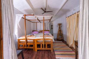 A bed or beds in a room at Sea Star Resort