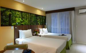A bed or beds in a room at Mercure Rio de Janeiro Nova Iguaçu