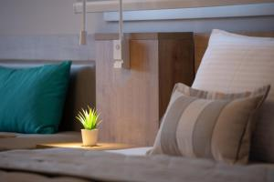 A bed or beds in a room at Hotel Agni On The Beach