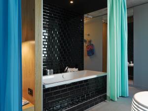 A bathroom at 25hours Hotel Langstrasse