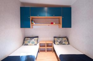A bed or beds in a room at Camping Village Baia Blu La Tortuga