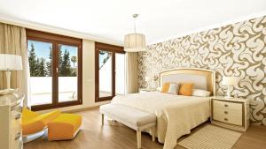 Säng eller sängar i ett rum på Villa Marina