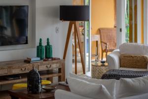 A seating area at Vila d'este Handmade Hospitality Hotel