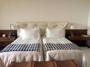 Cama ou camas em um quarto em Hotel Fasano Boa Vista