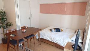 Haruyoshi Cuffe Studio / Vacation STAY 7318にあるベッド