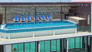 A view of the pool at Arena Beach Hotel or nearby