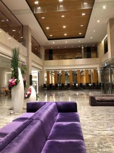 The lobby or reception area at Grand Royal Hotel