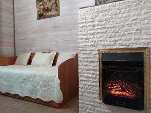 Кровать или кровати в номере Гостевой дом Подворье Ямщика