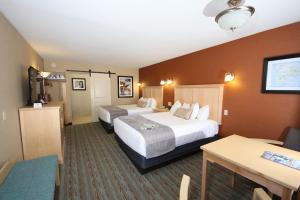 A bed or beds in a room at Best Western Acadia Park Inn