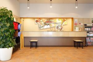 The lobby or reception area at AkishimaStationHotel TOKYO