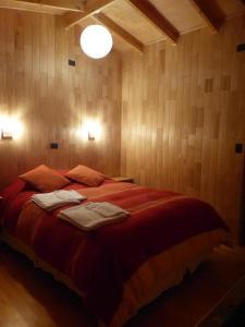 Cama o camas de una habitación en Cabañas Latitud 41 Sur