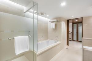 A bathroom at Pathumwan Princess Hotel - SHA Certified