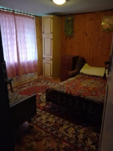 A bed or beds in a room at U Nikolaevny Guesthouse