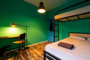 A bunk bed or bunk beds in a room at Trinity Hostel & Tours