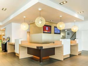 The lobby or reception area at ibis Berlin Messe