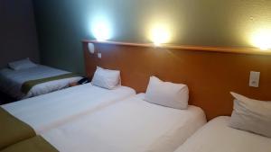 Un ou plusieurs lits dans un hébergement de l'établissement Euro Hôtel Paris Créteil