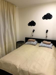 Voodi või voodid majutusasutuse Raasiku Hotell toas