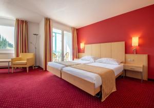 Un ou plusieurs lits dans un hébergement de l'établissement Hotel et Centre Thermal d'Yverdon-les-Bains