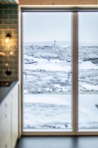 Aska, Modern Cabin að vetri til