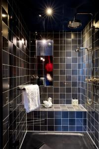 A bathroom at 25hours Hotel The Royal Bavarian