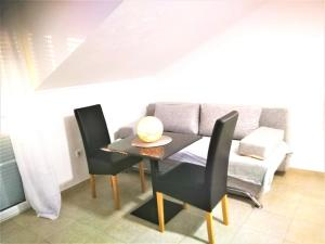A seating area at Apartments Milic
