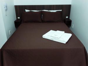 Cama ou camas em um quarto em Hotel Chave de Ouro