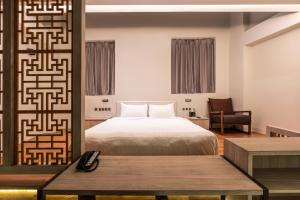 A bed or beds in a room at The Quay Hotel (SG Clean, Staycation Approved)