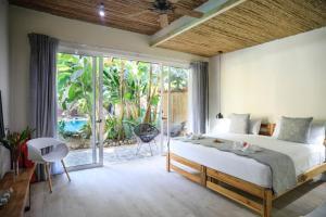 Cama o camas de una habitación en Manala Hotel