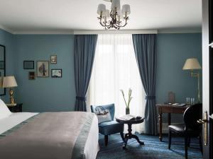 Un ou plusieurs lits dans un hébergement de l'établissement Hotel Rotary Geneva - MGallery