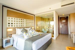 A bed or beds in a room at Jimbaran Bay Beach Resort and Spa by Prabhu