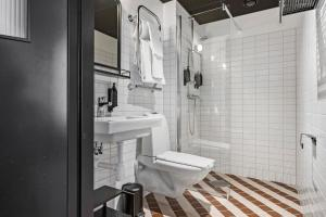 A bathroom at Hotel Giò; BW Signature Collection