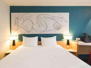 Un ou plusieurs lits dans un hébergement de l'établissement ibis Reims Centre Gare