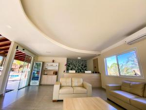 Uma área de estar em Villa de Holanda Parque Hotel