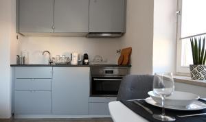 A kitchen or kitchenette at Gemütliches Appartement mit Netflix, Nespresso und Boxspringbett