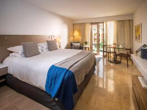 A bed or beds in a room at Sofitel Legend Santa Clara Cartagena
