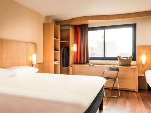 Ένα ή περισσότερα κρεβάτια σε δωμάτιο στο ibis Paris 17 Clichy-Batignolles (ex Berthier)