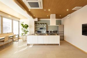 A kitchen or kitchenette at R Star Hostel Kyoto