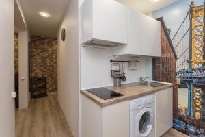 A kitchen or kitchenette at Metro Krasny Prospekt Apartment