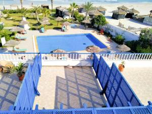 A view of the pool at Hotel de charme et SPA Dar El Bhar or nearby