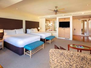 A bed or beds in a room at Pullman Reef Hotel Casino