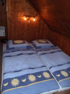 A bed or beds in a room at Penzion Mikeš