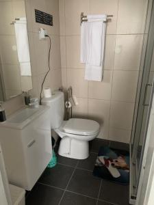 Een badkamer bij Residência Céu Azul
