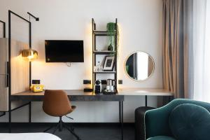 A television and/or entertainment center at Ariane Hotel