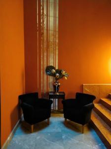 A seating area at Hotel Porta Felice & Spa