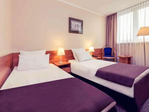 A bed or beds in a room at Hotel Mercure Toruń Centrum